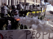 Riot police using tear gas on 21 April 2001 against protestors at the Quebec City Summit of the Americas