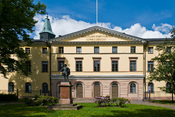 Court of Appeal, Academy House, Turku, with Turku Cathedral's tower on the background, and a statue of Gustav II Adolf, the founder of the Court of Appeal, on the foreground.