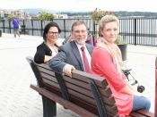 Social Development Minister Nelson McCausland pictured with Lisa Williamson (R) and Emma McLaughlin (L) during his visit to Queens Quay, Londonderry