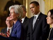 English: Kathleen Sebelius speaking after her official nomination as Secretary of Health and Human Services. President Barack Obama is standing behind Sebelius