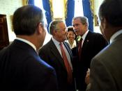 Before the signing ceremony of the Sarbanes-Oxley Act, President George W. Bush meets with Senator Sarbanes, Secretary of Labor Elaine Chao and other dignitaries in the Blue Room of the White House July 30, 2002.
