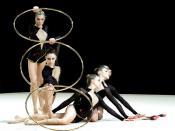 A group of rhythmic gymnasts posing.