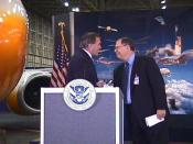 English: Seattle, WA, July 24, 2003 --Secretary of Homeland Security Tom Ridge (L) and Boeing Company Chairman and CEO Phil Condit talk to employees and press at a Boeing Field hanger in Seattle. Photo by Mike Howard/FEMA News Photo