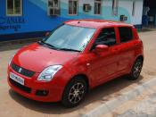 English: A Maruti Suzuki Swift VXi 2009 model.