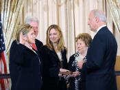 Vice President Biden swears in Secretary of State Hillary Rodham Clinton. Joining Secretary Clinton is her husband, former President Bill Clinton, their daughter Chelsea Clinton, and Secretary Clinton's mother Dorothy Rodham.