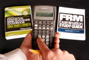 English: An FRM candidate demonstrates the use of the Texas Instruments BA II Plus calculator, one of a handful of models permitted to be used on the Financial Risk Manager exam.