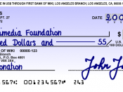 Cheque sample for a fictional bank in Canada using par-crossing MICR encoding for cashing in the United States. Created by Sergio Ortega based on real cheque standards.