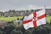 English: Flag over The Fountain area, Derry, Londonderry, Northern Ireland, August 2009