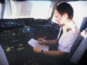 A pilot of a DC-10 consulting his checklist.