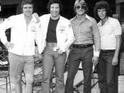 Vocalist Tom Jones, second from left, standing with band members for a group portrait: Fort Lauderdale, Florida