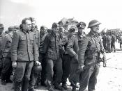 German forces surrendering to Canadian troops in Courseulles-sur-Mer.