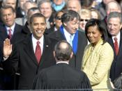 With his family by his side, Barack Obama is sworn in as the 44th president of the United States by Chief Justice of the United States John G. Roberts, Jr. in Washington, D.C., Jan. 20, 2009. More than 5,000 men and women in uniform are providing military