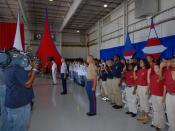 US Navy 070503-N-5142K-038 Members of the Army, Navy, Marine Corps, Coast Guard and Air Force Junior Reserve Officers' Training Corps raise their hands to enlist