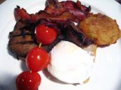 meat, tomatoes, sausage, bacon, bubbles & squeak, bread, and a poached egg at 202 cafe, inside Chelsea Market