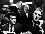 Tony Curtis as Sidney Falco and Burt Lancaster as J. J. Hunsecker