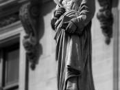 A statue of Froissart, who described the encounter at Noyon.