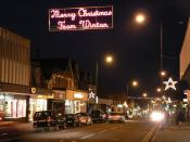 English: Merry Christmas from Winton Wimborne Road, the main shopping street through Winton, is bedecked with lights on the run-up to Christmas.
