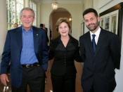 Khaled Hosseini at the White House in 2007, with Bush and Laura Bush.