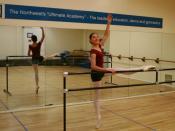 English: A ballet dancer doing barre work.