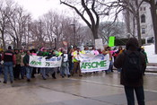 English: Protesters from the AFSCME march around the Wisconsin State Capitol, demonstrating against Governor Scott Walker's collective bargaining restriction on unions.