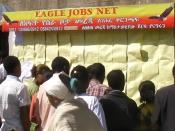 English: Job seekers in central Addis Ababa, Ethiopia review advertised opportunities
