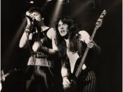 Steve Harris of Iron Maiden playing live with original singer Paul Di'Anno.