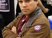 English: Max Brooks shows off his Rocket Llama patch at Wizard World-Texas. 2008. Licensing: Brooks, Max