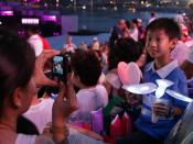 English: A boy with two of the devices provided to audience members in their audience participation kits at the opening ceremony at , .