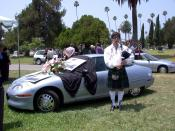 English: EV1 funeral held as a protest to General Motors decision to terminate all EV1 leases and crush the electric cars. The funeral was held at Hollywood Forever Cemetery on July 24, 2003