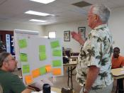 Master Watershed Stewardship volunteers discuss event displays at the Water Conservation and Quality of Life in the Valley of the Sun workshop on communicating outdoor water conservation techniques.