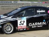 English: From BTCC Media Day held at Rockingham Speedway. Image of Gordon Shedden's 2009 Honda Civic. Now Halfords have pulled out their sponsorship of the team the car has changed colour from Orange to Black.