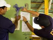 """English: Yauco, PR, October 25, 2008 -- Domingo Soto, owner of local business """"Sol Criollo"""" places FEMA flyer with the help of Eddie Vasquez from Community Relations. FEMA teams visited residences, businesses and community organizations during o"""