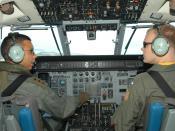 US Navy 030625-N-0493B-004 Royal Brunei Air Force (RBAF) pilot, Capt. Mohammad Sharif talks to his co-pilot, U.S Navy pilot Lt. j.g. Andrew Neboshynsky