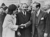 Mayor Wagner greets Dr. & Mrs. Martin Luther King, Jr. at City Hall / World Telegram & Sun photo by Phil Stanziola. Coretta Scott King shakes hands with New York City Mayor Robert Wagner as Dr. Martin Luther King, Jr. stands between them.