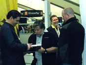 English: Steve Wozniak, co-founder of Apple, signs a Modbook for a fan during Macworld Expo 2009 while the CEO of Axiotron, Andreas Hass smiles on.