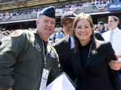"English: New York Air National Guard Maj. James T. Belton poses with former New York City Mayor Rudy Giuliani and wife Judith Giuliani at the ""New"" Yankee Stadium in Bronx, NY on 16 April 2009. Belton was assisting in the Four F-16C Fighting Falcons from"