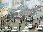 Police attack demo during the 2006 South African security guards strike. Photo: SATAWU