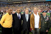 U.S. Army Gen. David H. Petraeus (far right), commander, U.S. Central Command, poses for a photo with NFL Commissioner Roger Goodell (center) and former players Lynn Swann, Roger Craig, and John Elway (second from right), during Super Bowl XLIII, Feb. 1,