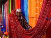 English: Sunday textile market on the sidewalks of Karachi, Pakistan. Français : Marché au tissus du dimanche sur les trottoirs de Karachi, au Pakistan. Canon EOS Digital Rebel / 18-55mm Canon lens
