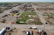 English: Greensburg, KS, June 4, 2007 -- One month ago Greensburg was demolished by an F5 tornado. Demolition crews have hauled out enough debris to fill a twelve-story office building the size of a football field. FEMA is paying seventy five percent of t