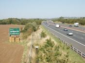 English: Billboard advertising by M40 motorway, near Waterperry Common. Posters are supposed to need planning consent, but there are now large numbers of advertisements visible from motorways. Most are on trailers, this one is just propped up on straw bal
