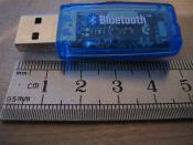 A USB Bluetooth adapter. (current image has a coin for comparison, this one has a ruler)