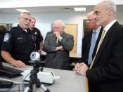 A U.S. Customs and Border Protection Officer addresses Dick Cheney (center), then Vice President of the United States, Saxby Chambliss (center right), a U.S. senator from Georgia and Michael Chertoff (far right), then United States Secretary of Homeland S