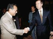 Prime Minister Dato' Seri Dr. Mahathir bin Mohamad greets U.S. Secretary of Defense William Cohen in Kuala Lumpur, Malaysia, the secretary's first stop.