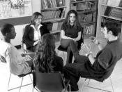 A photo of a group conducting psychotherapy.