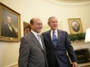English: President George W. Bush welcomes Romanian President Traian Basescu to the Oval Office at the White House Thursday, July 27, 2006 in Washington, D.C. White House photo by Eric Draper.http://georgewbush-whitehouse.archives.gov/news/releases/2006/0