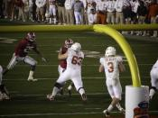 English: Garrett Gilbert throws against Alabama in the 2010 BCS National Championship Game.