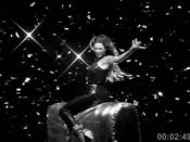 Knowles riding a mechanical bull in the music video
