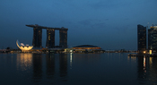 English: in Singapore at dusk.