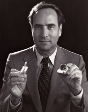 English: Theodore Maiman holding his invention of the world's first laser (invented May 16, 1960)